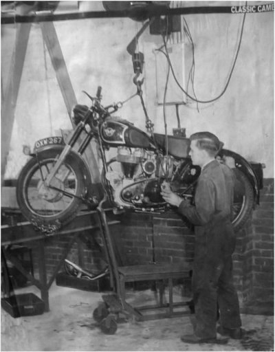 Bike on repair shop hoist pic