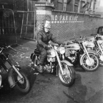 Brian Slark on Norton Twin exiting factory pic